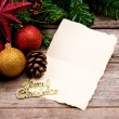 Stock Photo: Christmas decoration with blank vintage old paper over old wood
