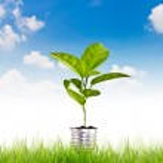 Green energy symbol over blue sky — Stock Photo