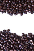 Close up of coffee beans cup shape on white background with copy — Stock Photo