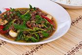 Thai spicy food, stir fried pork whit basil — Stock Photo