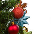 Red balls hanging from christmas tree — Stock Photo