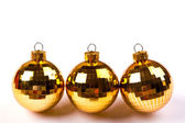 Shiny gold christmas balls on white background with copy space. — Stock Photo