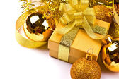 Golden gift box with golden ribbon — Stockfoto