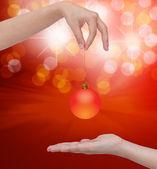 Human hand holding Transparent Christmas ball — Stock Photo