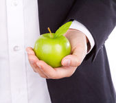 Businessman hand with a green apple in his hand isolate on white — Stock Photo