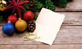 Christmas decoration with blank vintage old paper over old wood — Stock Photo