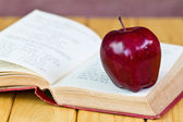 Stack of books with a red apple — Stock Photo