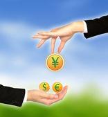 Hand bring up big euro sign — Stock Photo