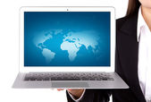 Businessperson holding an open laptop isolated on white backgrou — Stock Photo
