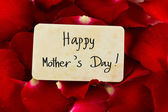 """Red rose petals and old card with word """" Happy Mother's Day """" — Stock Photo"""