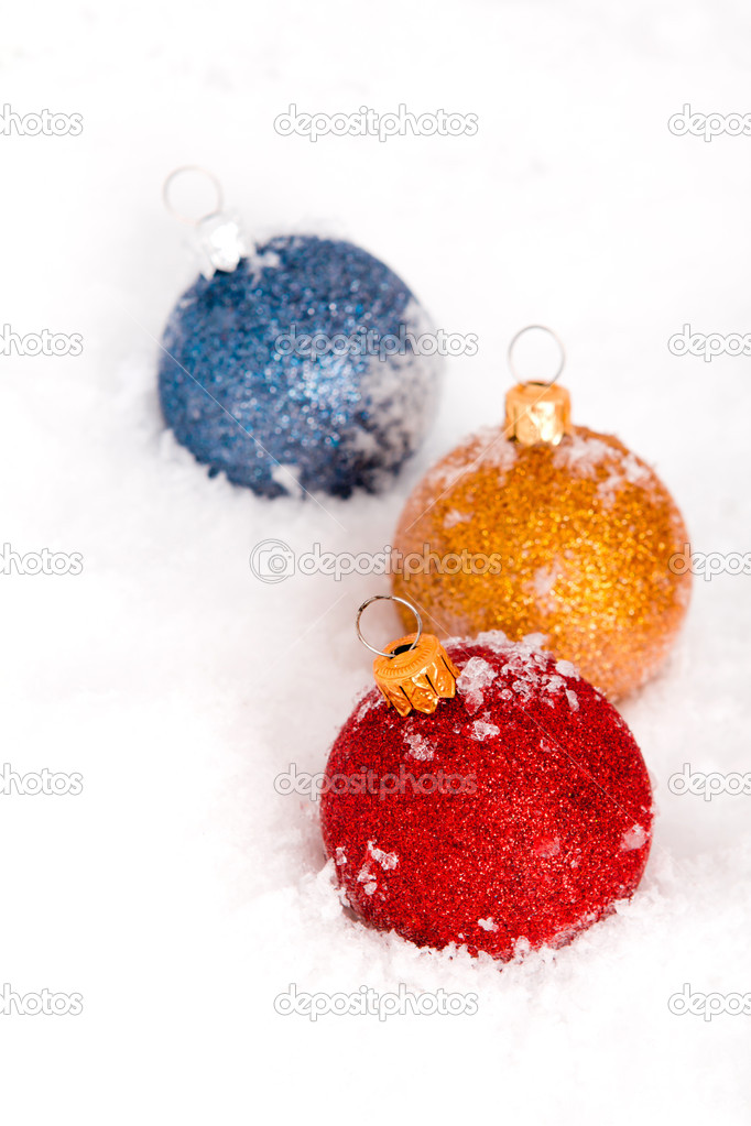 Blue ,red and gold christmas balls with snow  Stock Photo #10612355