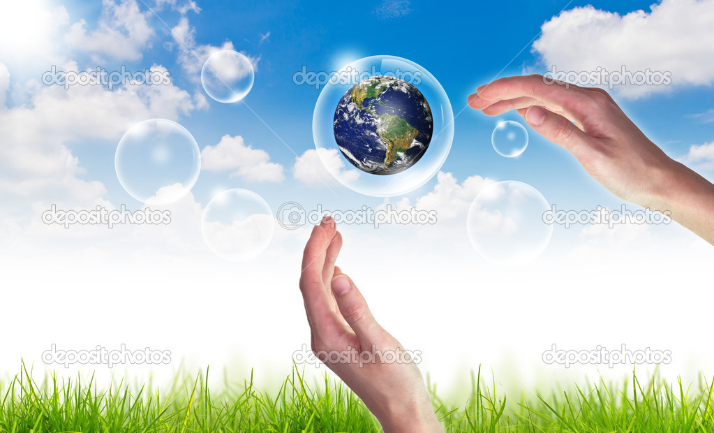 Eco concept : Hand hold globe in bubbles against the sun and the blue sky — Stock Photo #10615953
