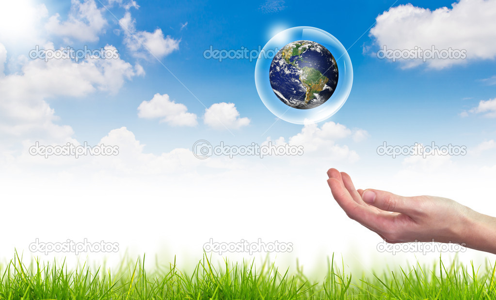 Eco concept : Hand hold globe in bubbles against the sun and the blue sky — Stock Photo #10615963