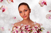 Girl with a white orchid — Stock Photo