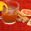 Glass of mulled wine on woven - Stock Photo