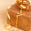 Two handmade hearts and gift box on gold background — Stock Photo