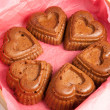 Muffins in a heart shape isolated on a white — Stock Photo