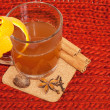 Glass of mulled wine on woven — Stock Photo