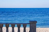Concrete fence on the background of the beach — Stock Photo