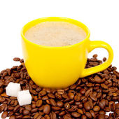 Yellow cup of coffee with beans — Stock Photo