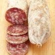 Salami on cutting board — Stock Photo