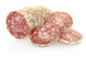 Salami and slices — Stock Photo