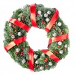 Christmas wreath with red ribbon and berries — Stock Photo