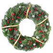 Christmas wreath with red berries and pine cones — Stock fotografie