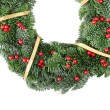 Foto Stock: Christmas wreath with red berries and gold ribbon