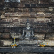 Stock Photo: Stone Buddhwith brick background