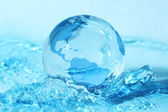 Glass globe in water — Stock Photo