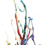 Colorful paint splashing isolated on white — Stock Photo