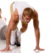 Track and field athlete at start of sprint. Studio shot over white. — Stock Photo