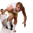 Track and field athlete at start of sprint. Studio shot over white. — Stock Photo #9008671