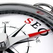 Seo the way indicated by compass - Stock Photo