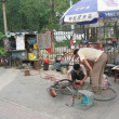 Chinese man fixing the bikes - ストック写真