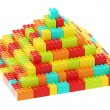 Stock Photo: Pyramid made of toy construction bricks