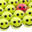 Sad smiley face among happy ones — Stock Photo