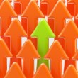 Royalty-Free Stock Photo: Green arrow among the orange ones