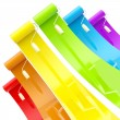 Rainbow paint rollers with color strokes — Stock Photo