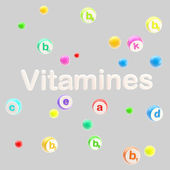 Vitamines word surrounded with pills and tablets — Stockfoto