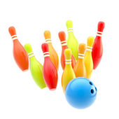 Bowling ball smashing to colorful pins isolated — Stock Photo