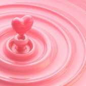Cream glossy waves with a heart like drop — Stock Photo