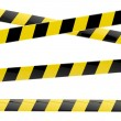 Black and yellow glossy barrier tapes isolated — Stock Photo