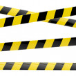 Royalty-Free Stock Photo: Black and yellow glossy barrier tapes  isolated