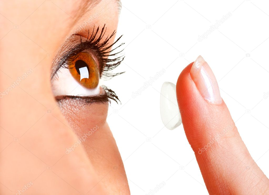 Closeup of a woman inserting a contact lens in her eye — Stock Photo #10411909