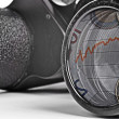 Old Binoculars Seeing Financial Crisis - Stock Photo