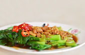 Stir fried chinese kale with oyster sauce — Stock Photo
