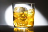 Whiskey in glass with ice and carabel — Stock Photo