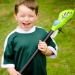 Happy young child lacrosse player with his stick — Stock Photo #10062705